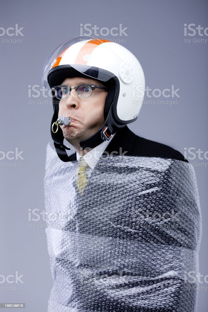 funny businessman blows the whistle while fully protected stock photo