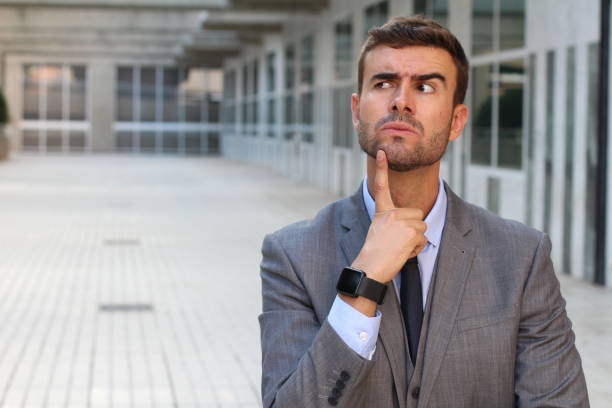 Funny businessman thinking really hard stock photo