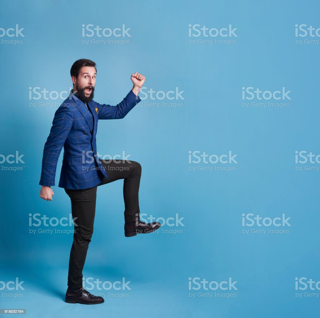 Funny businessman walking or exercising stock photo