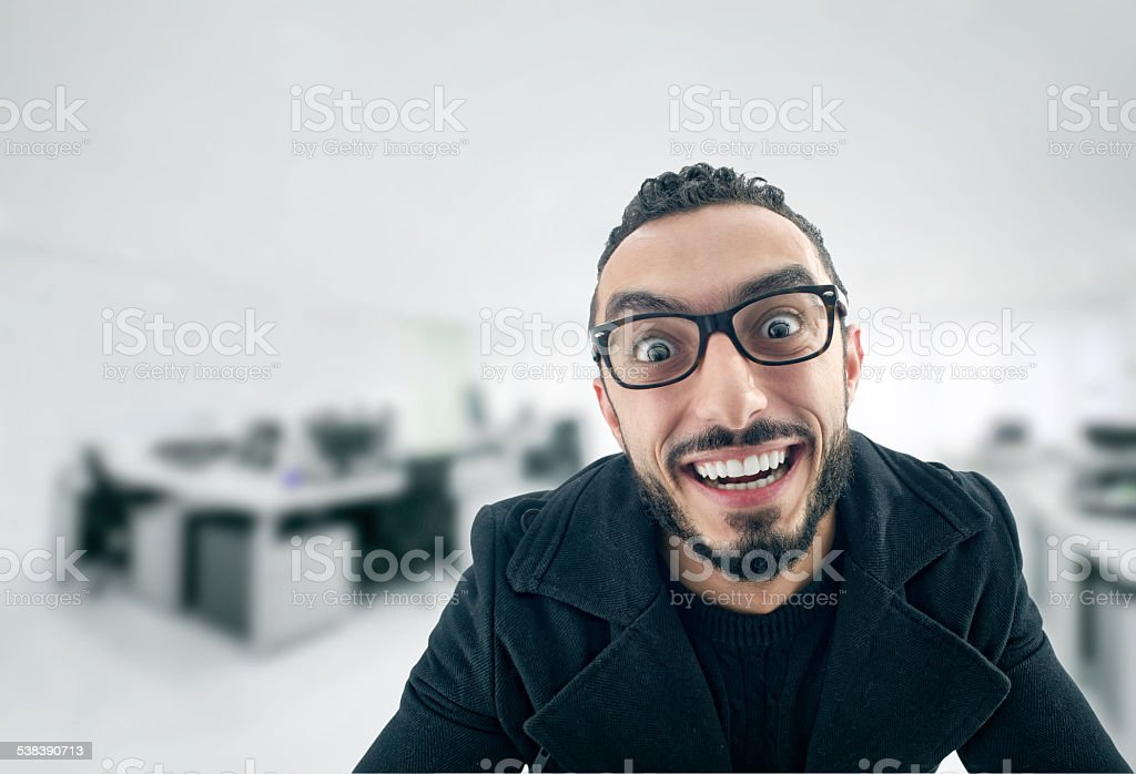Funny Businessman with crazy expression, Facial expression stock photo