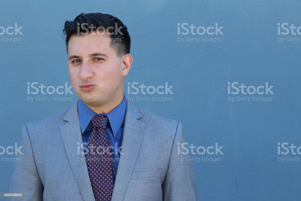 Funny businessman with 'duck face' expression stock photo