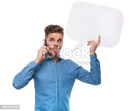istock funny casual man with speech bubble speaking on the phone 992032690