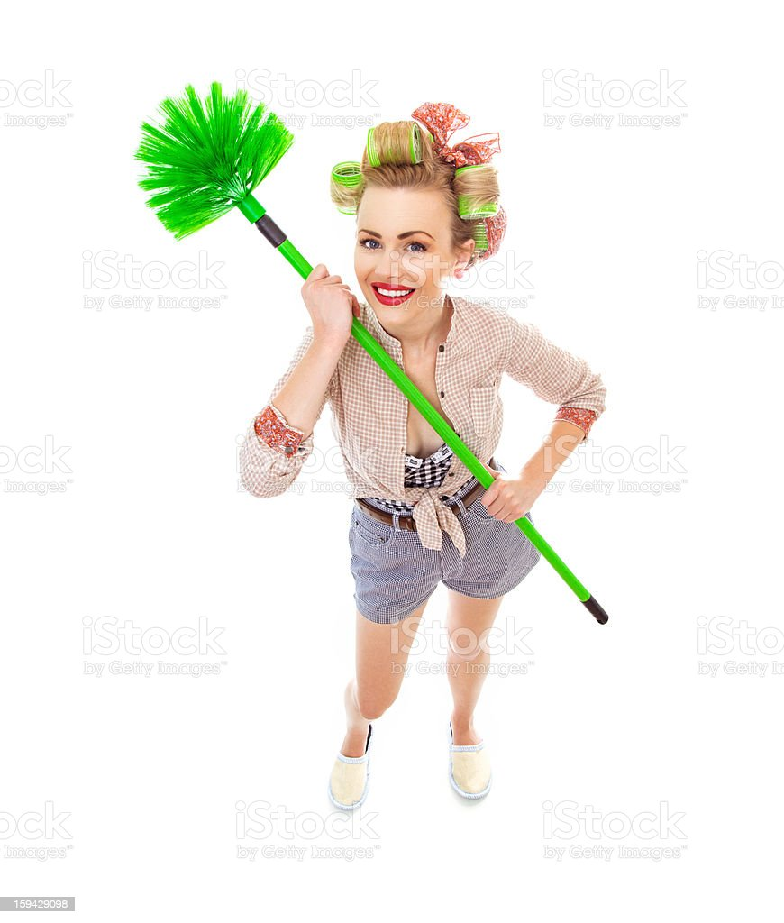 Funny cheerful smile housewife / girl with broom royalty-free stock photo