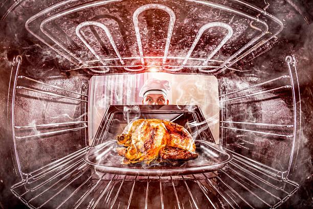 engraçado chef perplexo e zangado. perdedor sai do destino! - burned oven imagens e fotografias de stock