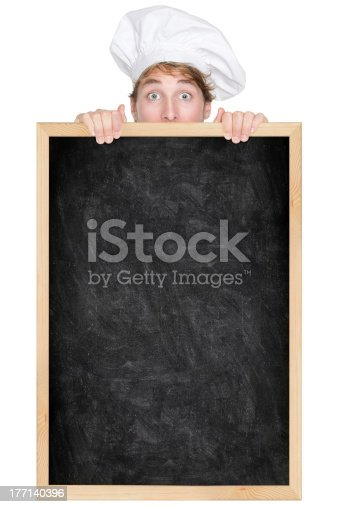 875677322istockphoto Funny chef showing blackboard menu sign 177140396