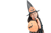 istock funny child girl in witch costume for Halloween 1030445852