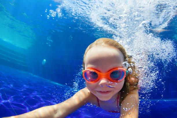 funny child in goggles dive in swimming pool - jump pool, swimmer imagens e fotografias de stock