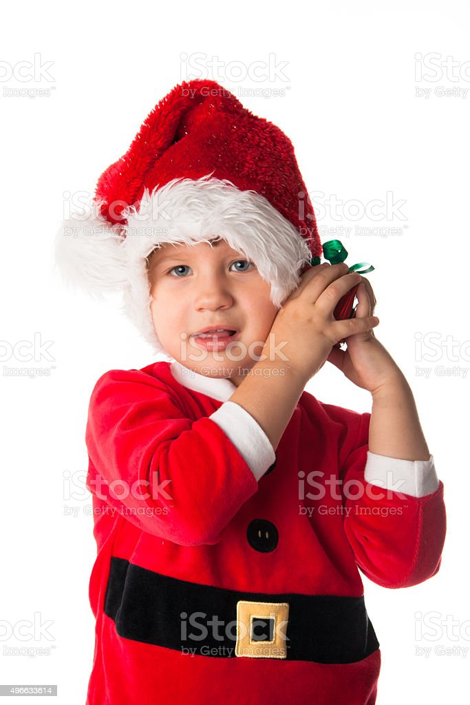 158e87e1b3c15 funny child Santa red hat holding Christmas gift in hand royalty-free stock  photo