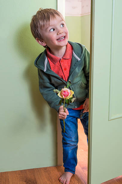 Funny child with a flower stock photo