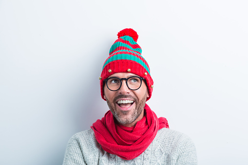 Funny Christmas Portrait Of Nerdy Man Wearing Elf Cap Stock Photo - Download Image Now