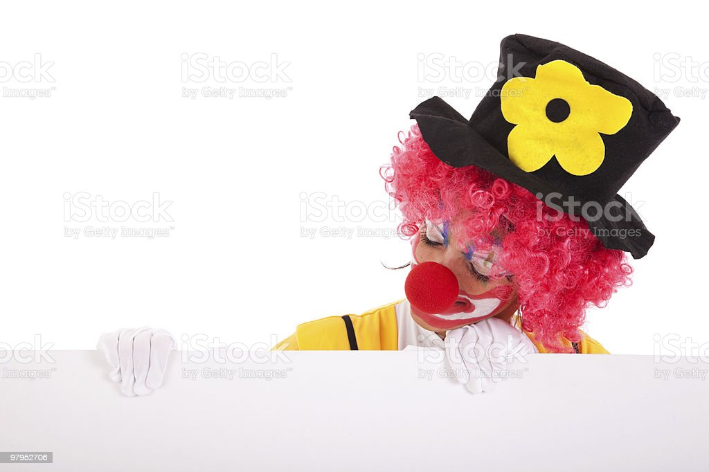 funny clown holding a banner royalty-free stock photo