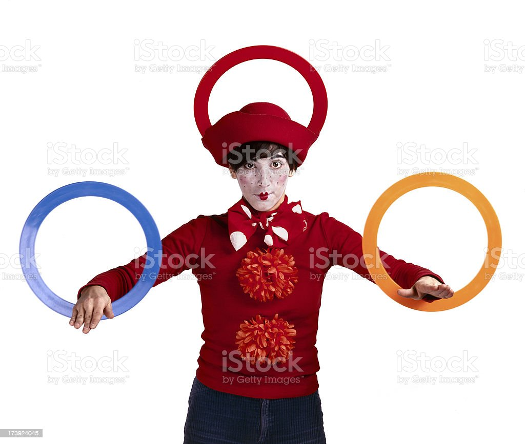 Funny clown juggling three colored rings stock photo