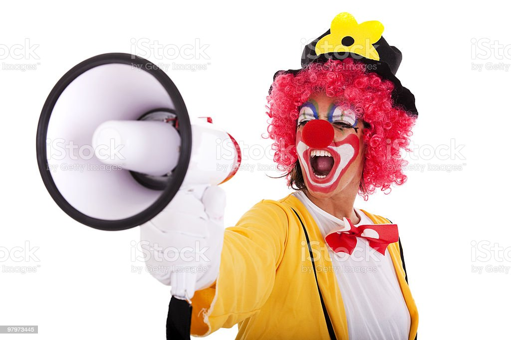 Funny clown with a megaphone royalty-free stock photo