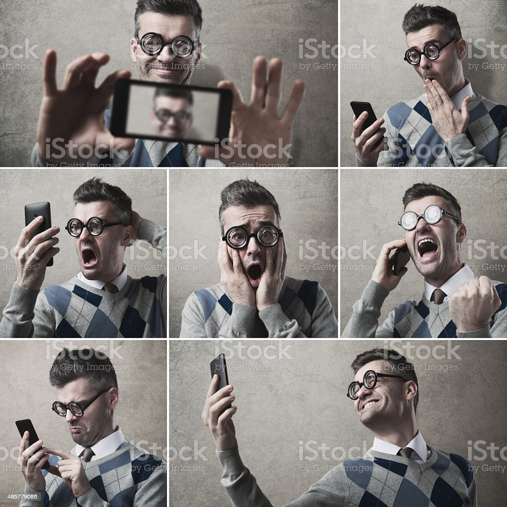 funny clueless guy with his smartphone stock photo