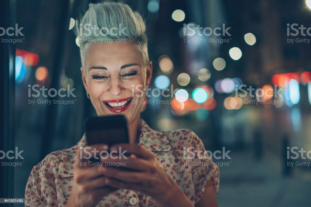 Funny communication at night in the city stock photo
