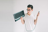 istock Funny computer geek isolated on white. Nerd is wearing glasses. 1098366580