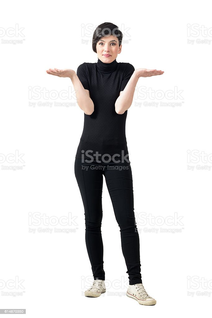 Funny confused clueless young woman shrugging shoulders stock photo