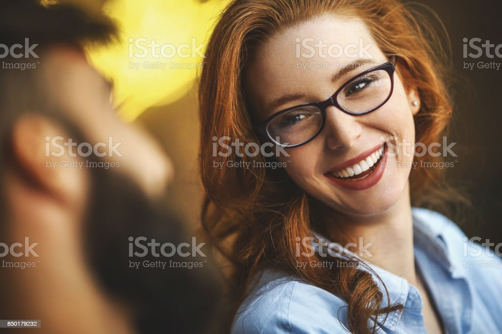Funny conversation at a coffee place. stock photo