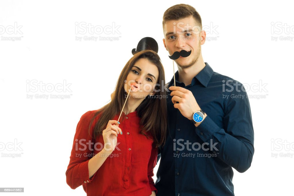 funny couple holding paper Dummies for photo and looking at camera stock photo