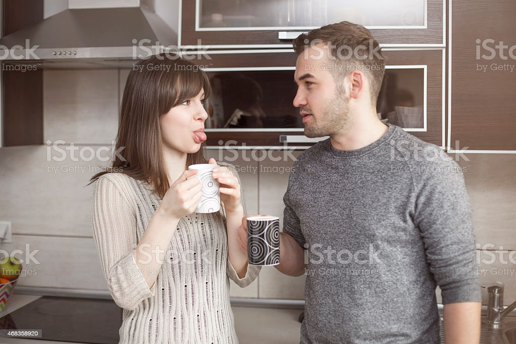 Funny couple joking in kitchen royalty-free stock photo
