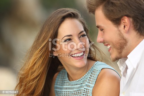 istock Funny couple laughing with a white perfect smile 516250041