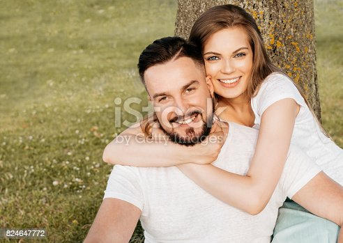 507375092istockphoto Funny couple laughing with a white perfect smile 824647772