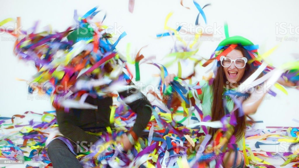 Funny Couple Make Fireworks From Colorful Ribbons стоковое фото