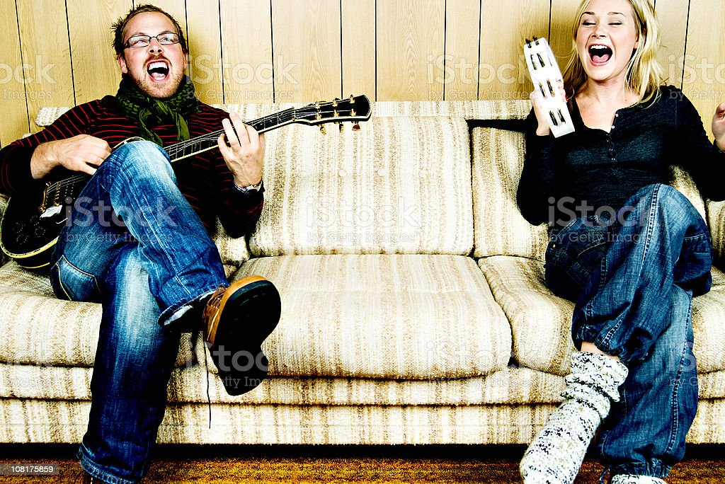 Funny couple playing music stock photo
