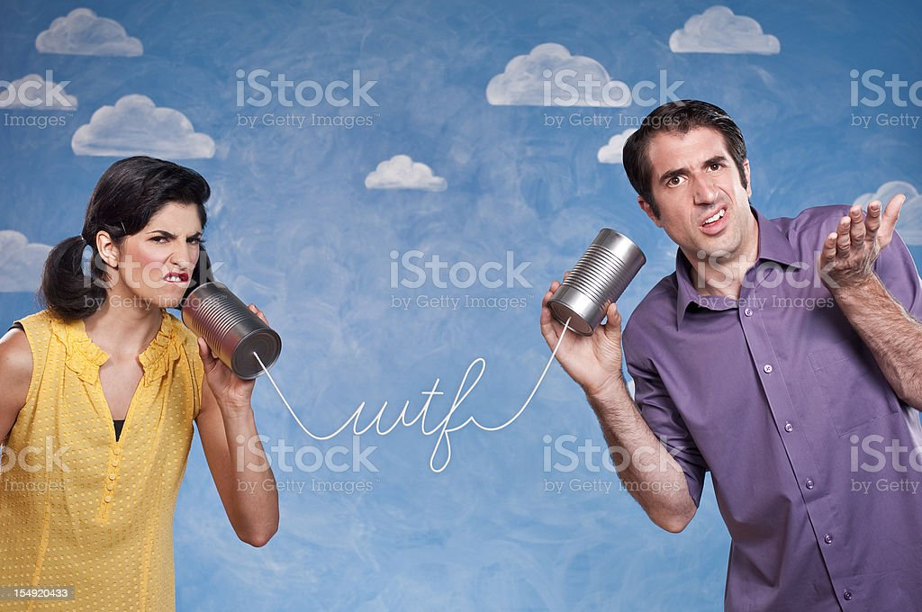 Funny Couple With Tin Can Telephones royalty-free stock photo