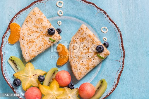 istock Funny crepes pancakes looks like a fish 674793190