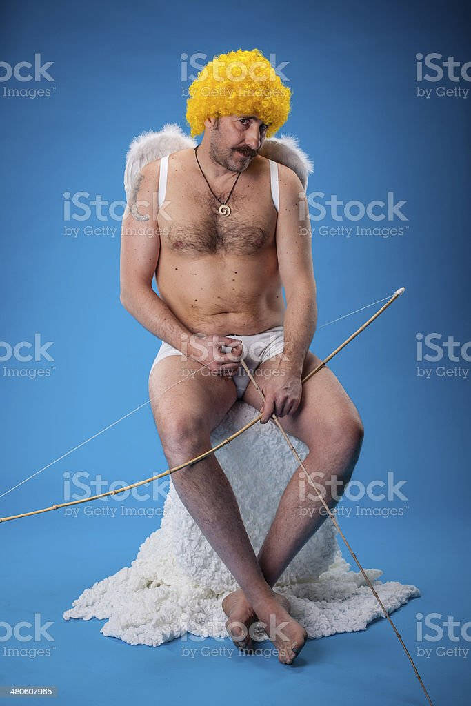 Funny Cupid Tired stock photo