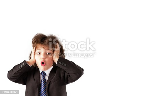 istock Funny curly boy in business suit stares into the camera. 636476372