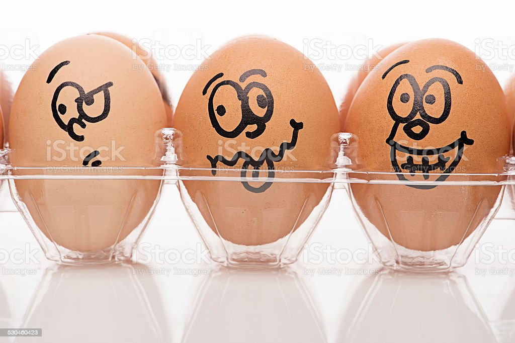 Funny Drawing Faces on Eggs stock photo