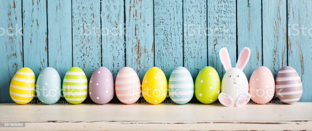 Funny Easter Egg Rabbit on Shelf stock photo