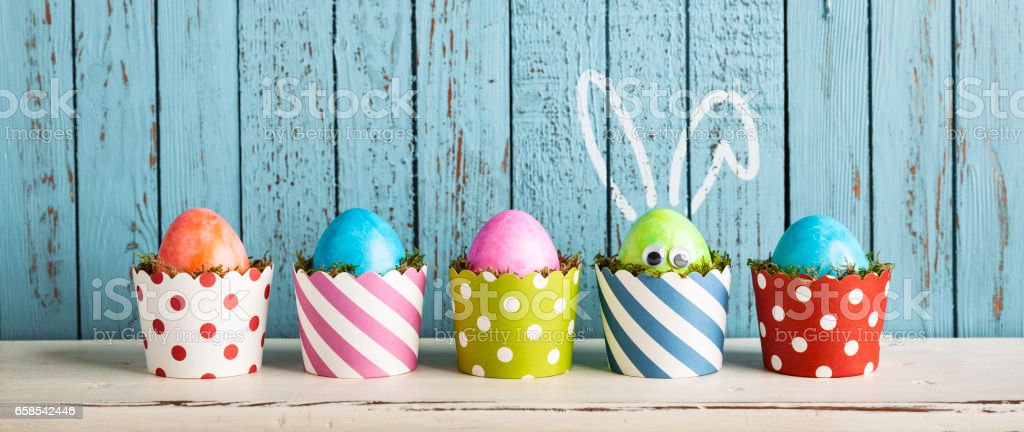 Funny Easter Eggs in Cake Pans - Rabbit Ears Humor stock photo