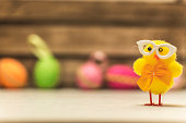 Funny easter background with yellow baby chicken nerd