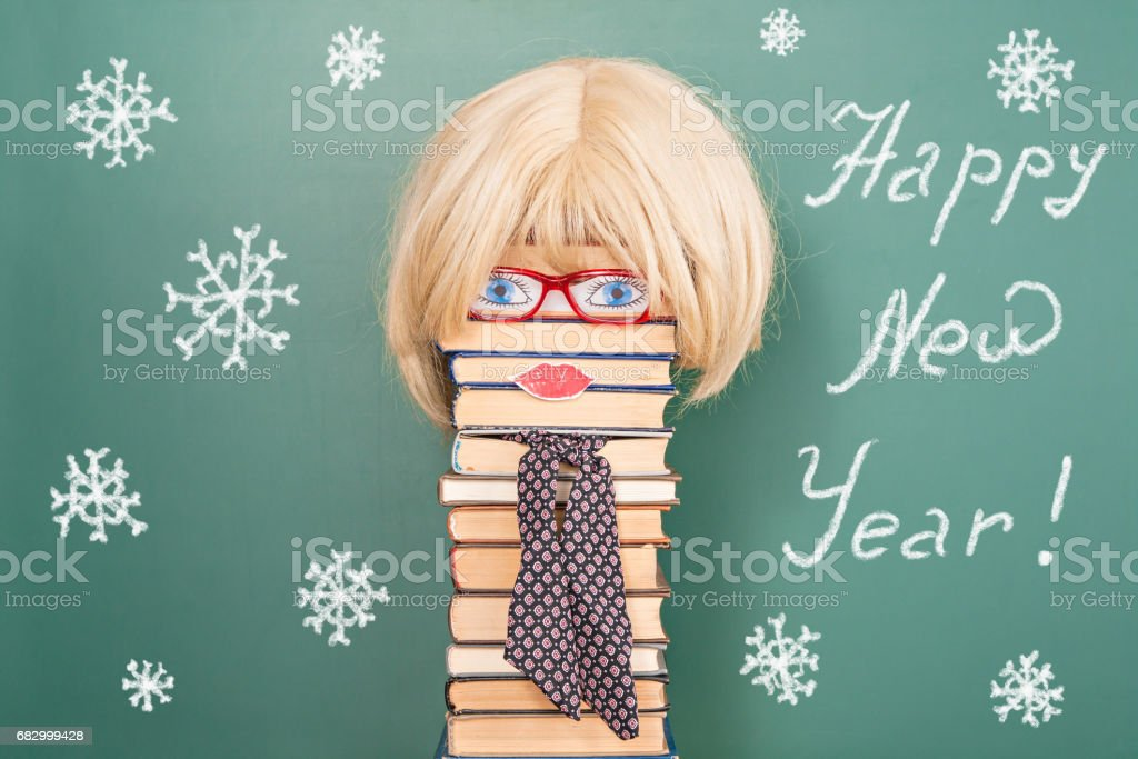 Funny education idea, woman teacher in front of blackboard with copy space royalty-free stock photo
