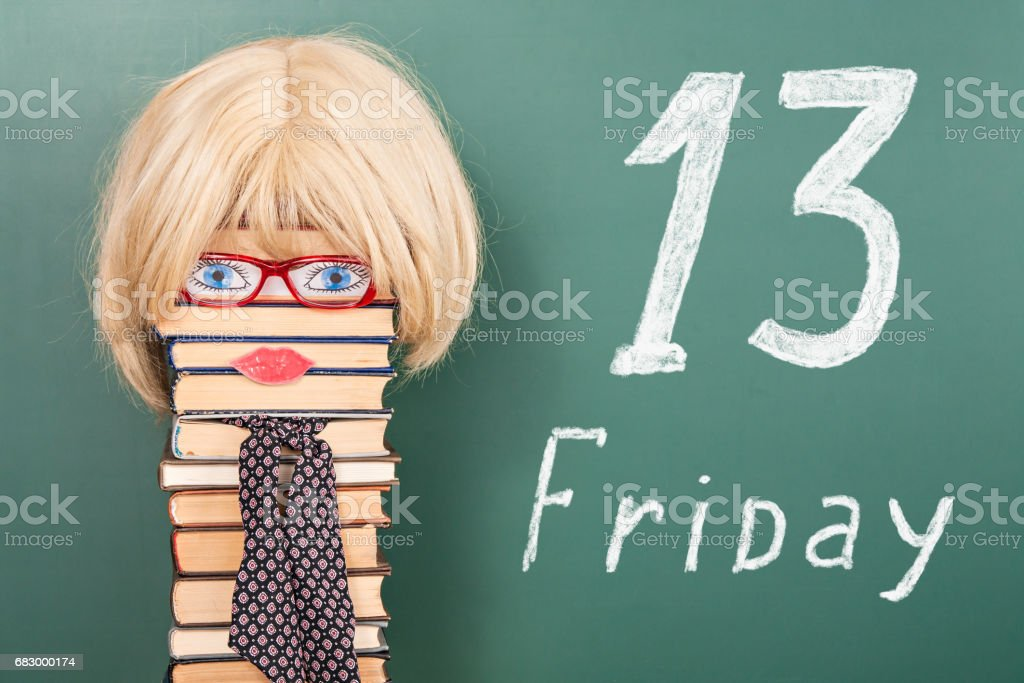 Funny education idea, woman teacher in front of blackboard with title 13 FRIDAY royalty-free stock photo