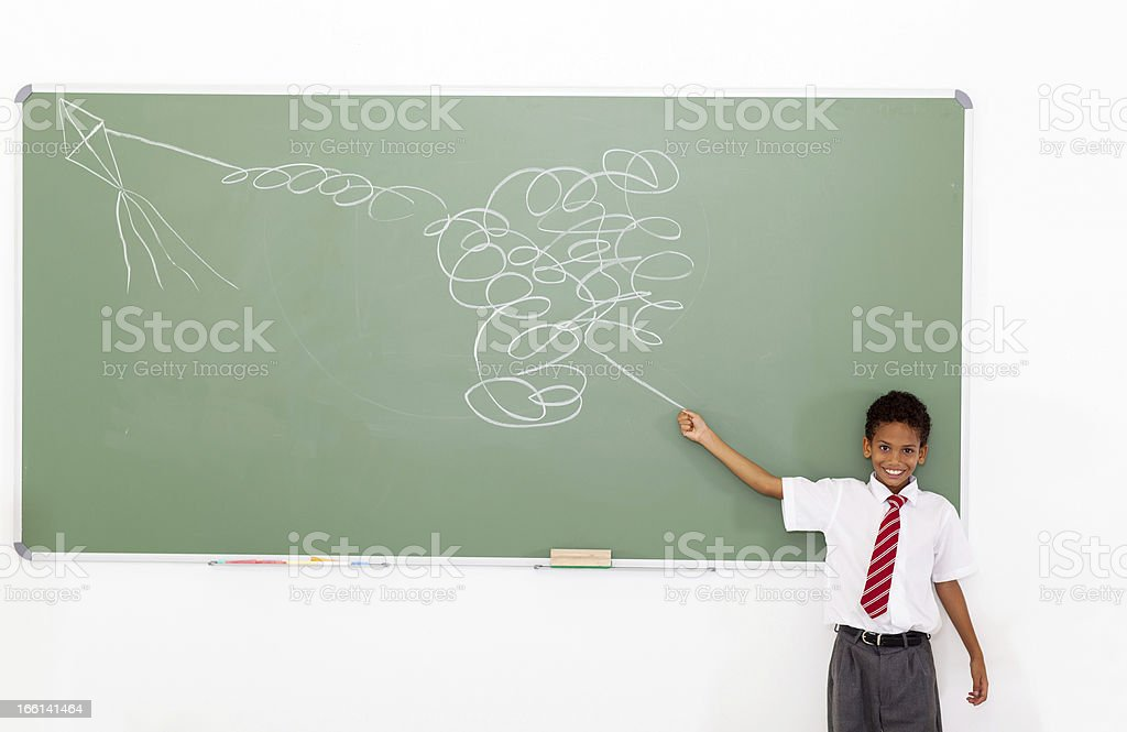 funny elementary schoolboy flying a impossible kite royalty-free stock photo
