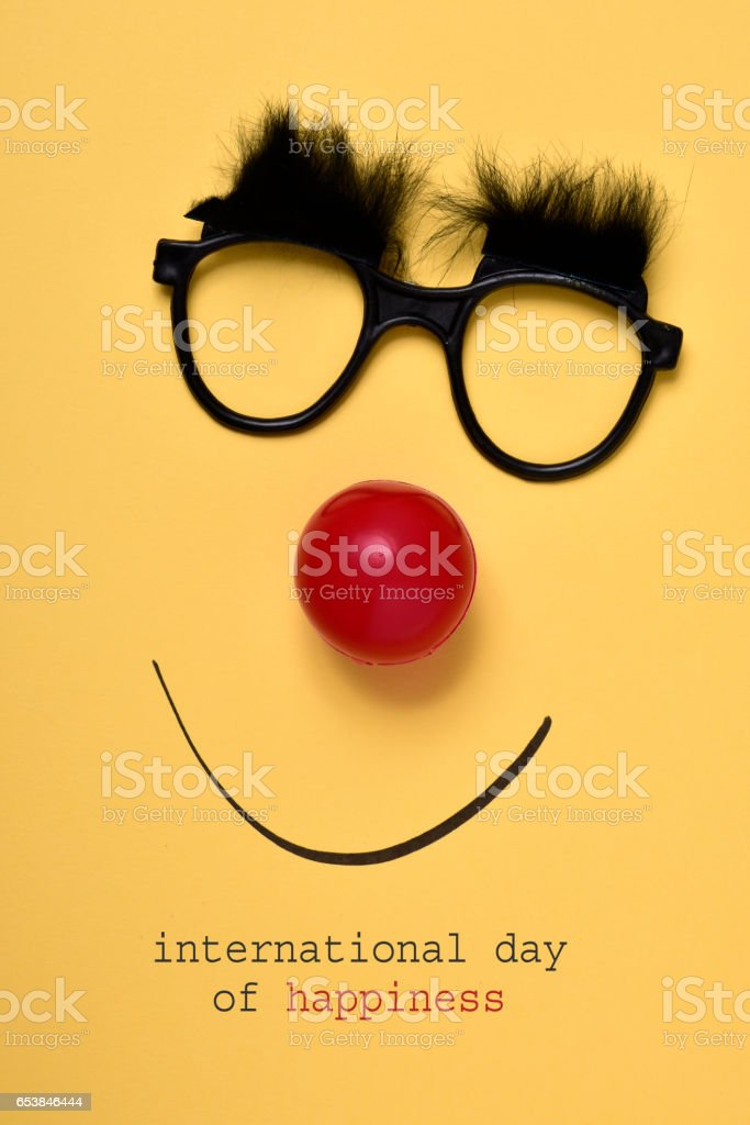 funny face and text international day of happiness stock photo