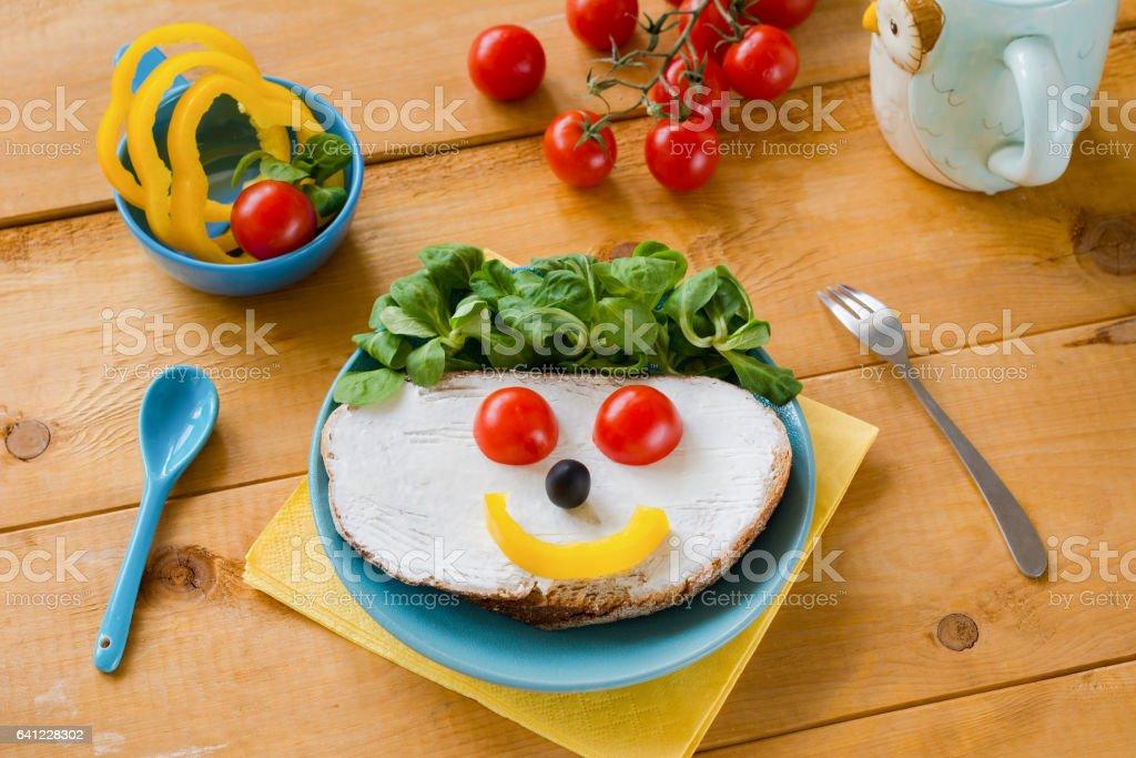 Funny face breakfast sandwich for kids stock photo