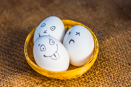 Funny Faces Drawn On The Eggs Which Are In A Traditional