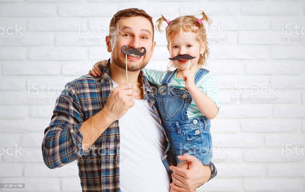 funny family father and child with a mustache stock photo