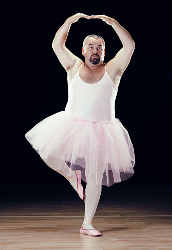 Funny Fat Classical Dancer On Black Background Stock Photo - Download Image Now