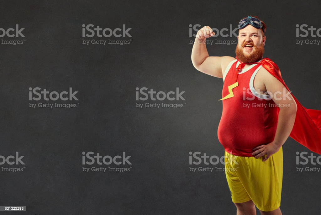 A funny fat man in a superhero costume stock photo