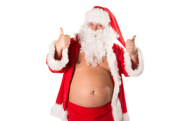funny fat santa is undressing. - naked santa claus stock pictures, royalty-free photos & images