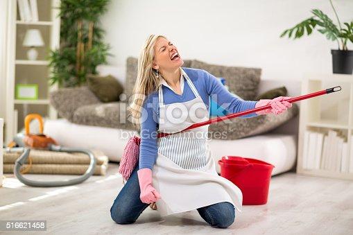 Funny female make joke while cleaning house stock photo for House cleaning stock photos