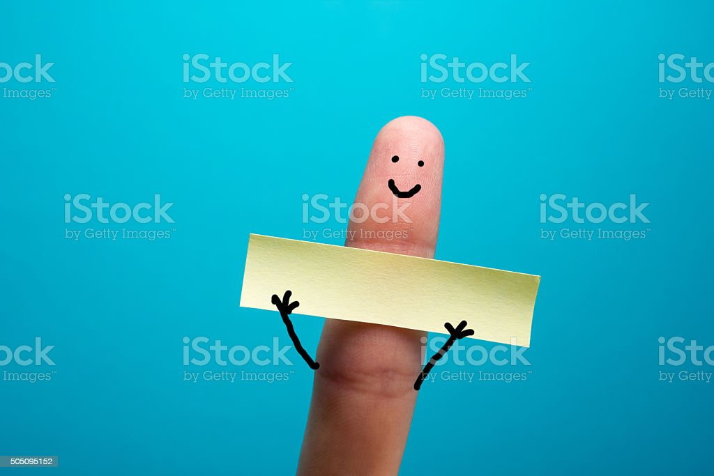 Funny finger holding blank bunner showing on it and smiling stock photo