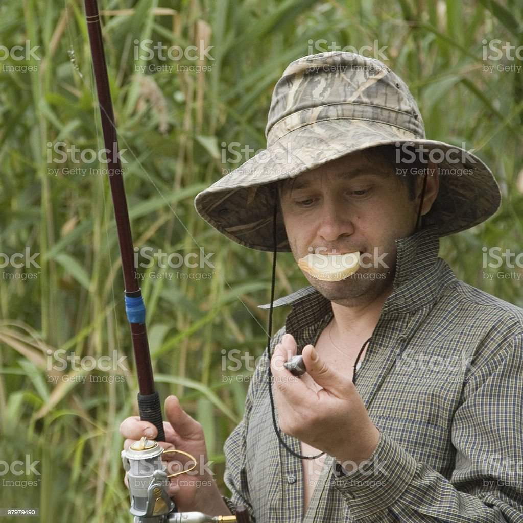 funny fisher's portrait with slice of bread in his mouth royalty-free stock photo