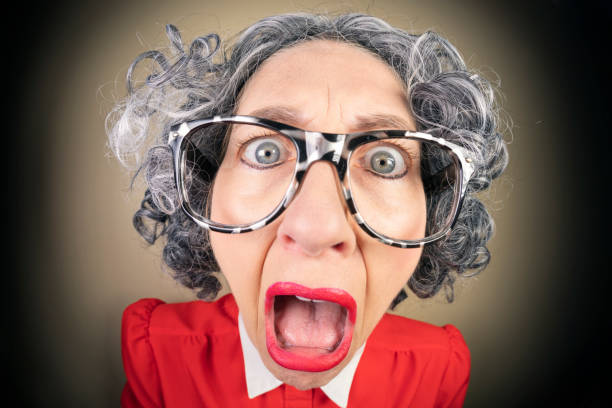 Funny Fisheye Nerdy Older Woman Appalled A humorous fisheye image of an older, nerdy woman with appalled expression on her face. sdominick stock pictures, royalty-free photos & images